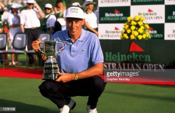 Portrait of Robert Allenby of Australia with the trophy after winning the Heineken Australian Open at the Royal Sydney Golf Club in Australia...