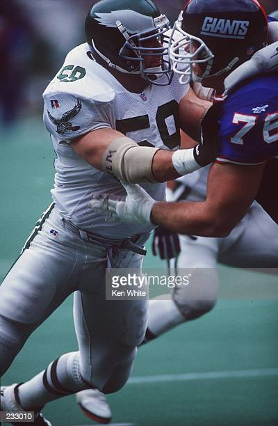 Defensive lineman Mike Mamula battles with offensive tackle John Elliott of the New York Giants during the Eagles 2819 victory over the Giants at...