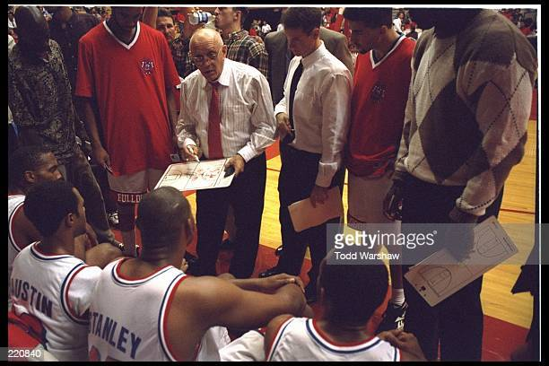 Fresno State Bulldogs head coach Jerry Tarkanian talks to his team during a game against Brewster at Selland Arena in Fresno California Fresno State...