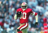 Jerry Rice of the San Francisco 49ers runs for a touch down during the game against the Dallas Cowboys at the Texas Stadium in Irving Texas The 49ers...