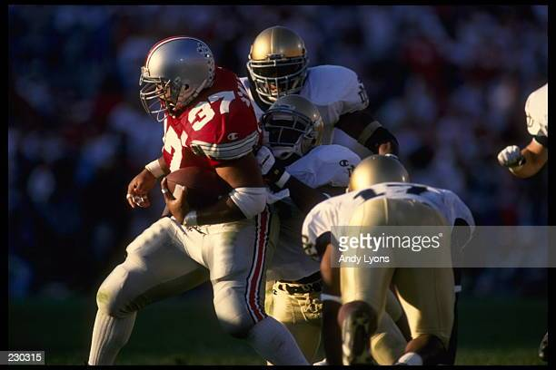OHIO STATE FULLBACK NICKY SUALUA RUMBLES DOWN FIELD WHILE BEING TACKLED BY PURSUING NOTRE DAME DEFENDERS DURING THE BUCKEYES'' 4526 VICTORY