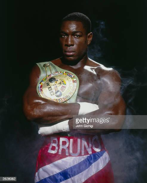Nov 1995 World Boxing Council heavyweight champion Frank Bruno of Great Britain poses with the WBC belt in this moody studio portrait taken in...
