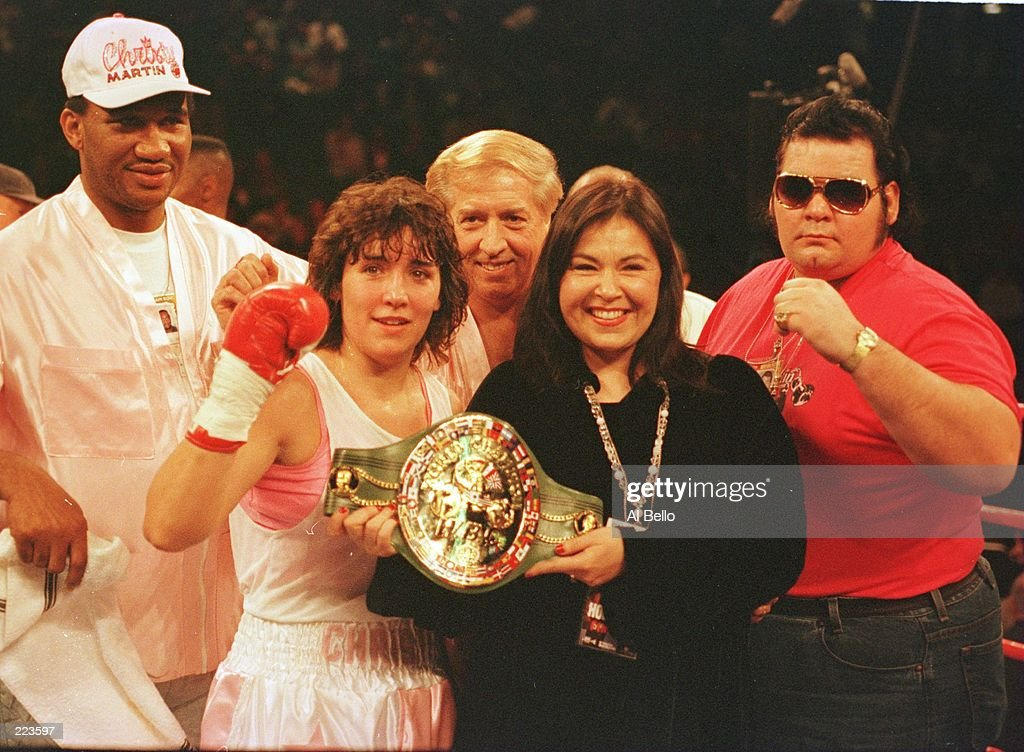 Christy Martin celebrates with Roseane Barr and her corner after defeating Bethany Payne by TKO in the 1st round at the MGM Grand Garden in Las Vegas, Nevada. Referee Kenny Bayliss stopped the fight with 1 second left in the 1st round