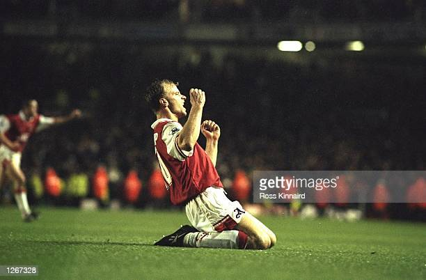 Dennis Bergkamp of Arsenal celebrates a goal during an FA Carling Premiership match against Tottenham Hotspur at Highbury Stadium in London Arsenal...