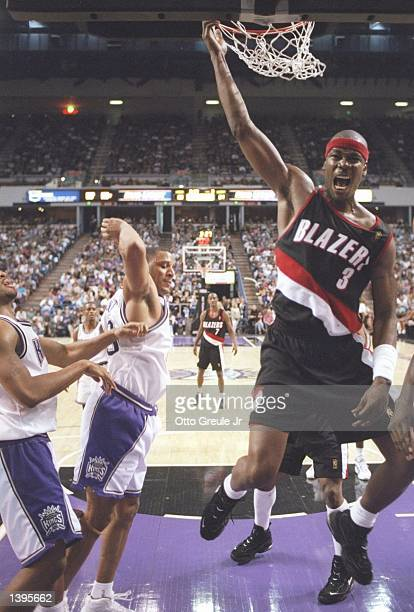 Forward Cliff Robinson of the Portland Trailblazers slam dunks the ball during a game against the Sacramento Kings at the Arco Arena in Sacramento...