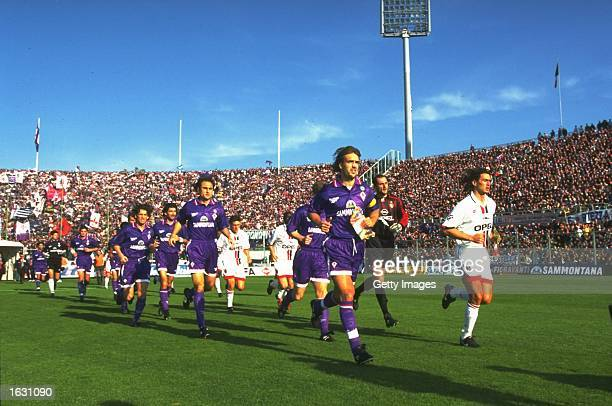 Gabriel Batistuta of Fiorentina and Paolo Maldini of AC Milan lead their teams onto the pitch before a Serie A match at the Artemio Franchi Stadium...
