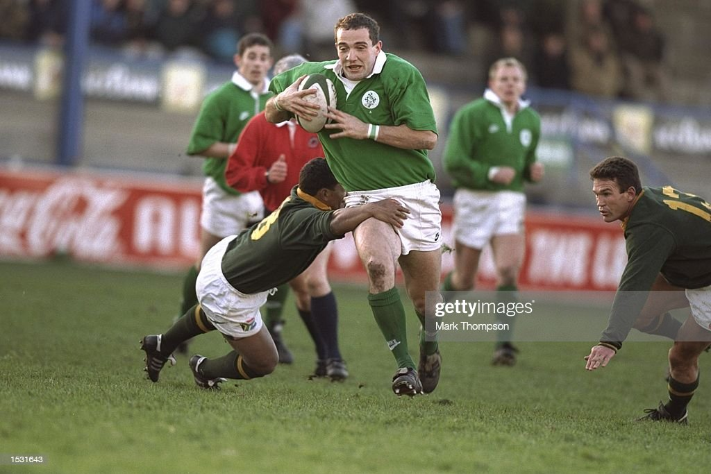 Geraldo Scholtz of South Africa (left) tackles Conor O'shea of Ireland during the match between Ireland ''A'' and South Africa ''A'' at Donnybrook, Ireland. Mandatory Credit: Mark Thompson/Allsport