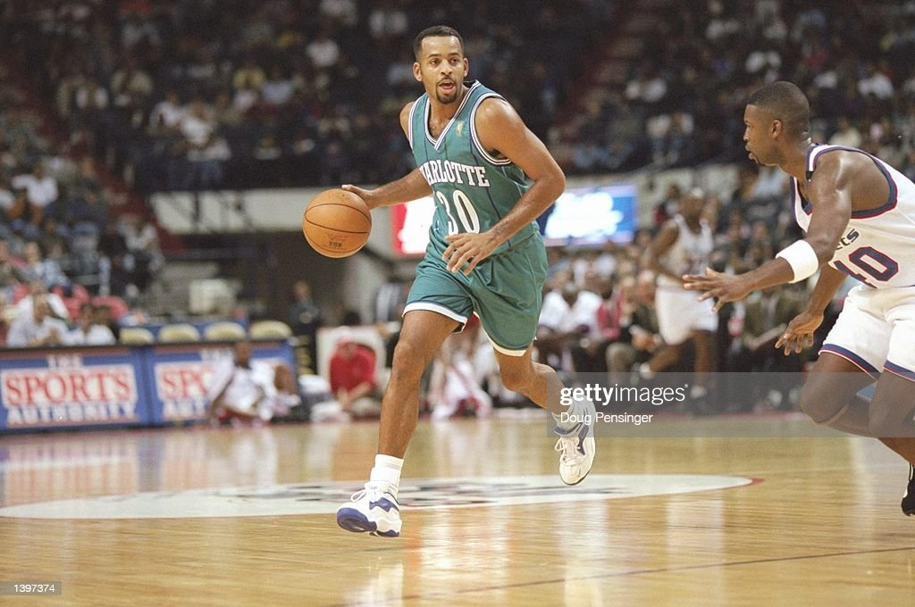 Guard Dell Curry of the Charlotte Hornets dribbles the ball down the court during a game against the Washington Bullets at the US Air Arena in...