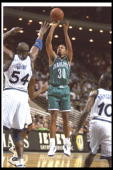 Guard Dell Curry of the Charlotte Hornets shoots the ball during a game against the Orlando Magic at the Orlando Arena in Orlando Florida The Magic...