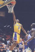 Guard Kobe Bryant of the Los Angeles Lakers lays up the ball during a game against the Utah Jazz at the Great Western Forum in Inglewood California...