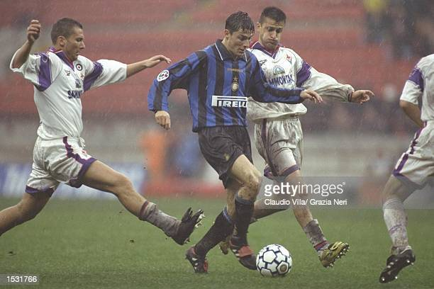 Javier Zanetti of Inter takes on the Fiorentina defence during the Serie A match between Inter Milan and Fiorentina at the San Siro Stadium in Milan...