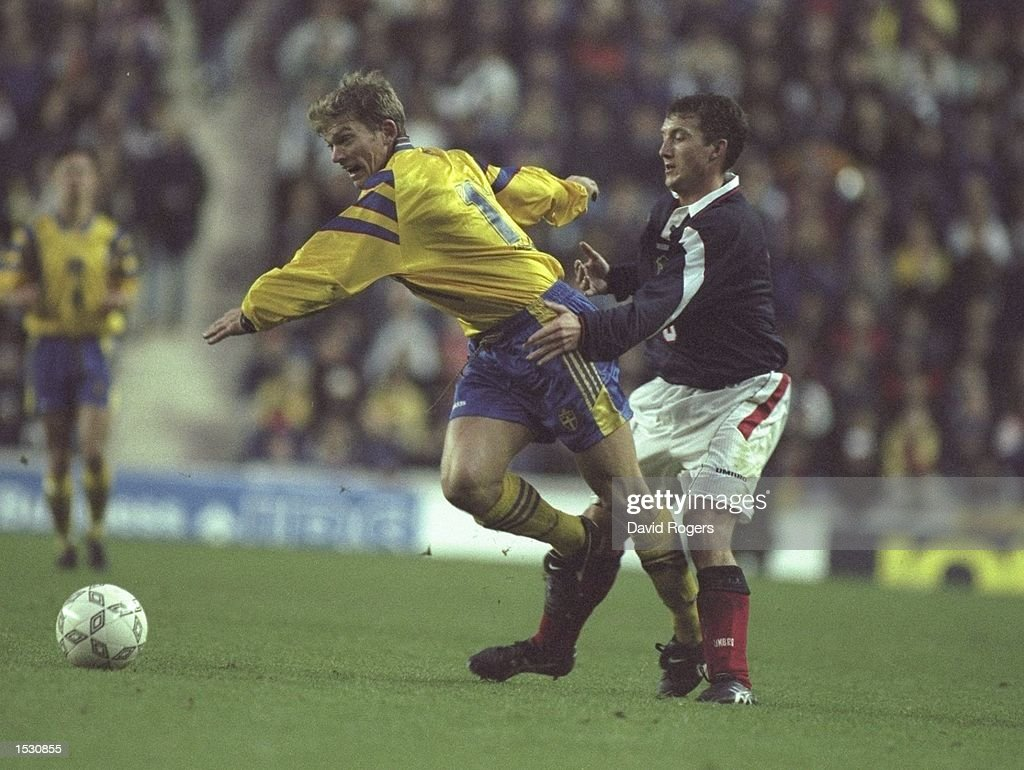 Jesper Blomqvist of Sweden is held back by Billy McKinlay of Scotland during the world cup qualifier between Scotland and Sweden at Celtic Park in Glasgow. Mandatory Credit: Dave Rogers/Allsport