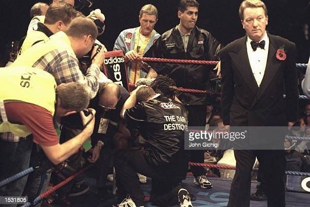 Nigel Benn is consoled after being retired by his cornermen at the end of the sixth round signalling the end of his illustrious career Promoter Frank...