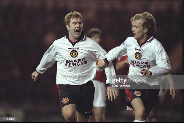 Paul Scholes of Man Utd celebrates with teammate Jordi Cruyff during the FA Carling Premier league match between Middlesbrough and Manchester United...