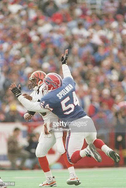 Quarterback Jeff Blake of the Cincinnati Bengals is sacked by linebacker Chris Spielman of the Buffalo Bills during the Bengals 3117 loss to the...
