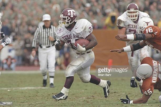Running back Dante Hall of the Texas AM Aggies runs down the field during a game against the Texas Longhorns at Texas Memorial Stadium in Austin...