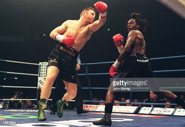 Steve Collins of Ireland swings and misses Nigel Benn with a left hook during the Benn v Collins rematch at the Nynex Arena in Manchester Steve...