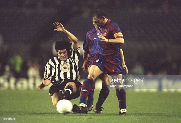 Alessandro Pistone of Newcastle United slides in to tackle Albert Ferrer of Barcelona during the Champions League match at the Nou Camp Stadium in...
