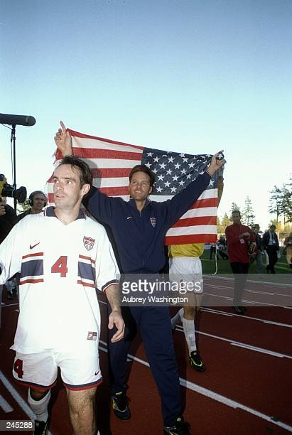Eric Wynalda of the USA holds up an American Flag in celebration after a 30 World Cup qualifying win over Canada at Swangard Stadium in Burnaby...