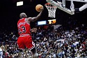 Guard Michael Jordan of the Chicago Bulls jumps to the basket during a game against the Washington Wizards at the US Airways Arena in Landover...