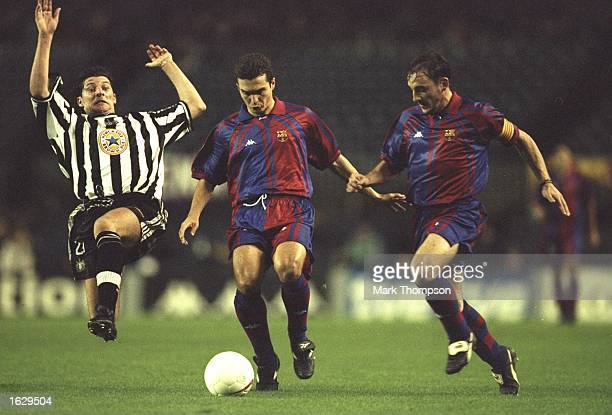 Guillermo Amor of Barcelona is supported by team mate Albert Ferrer as Alessandro Pistone of Newcastle United moves in to tackle during the Champions...