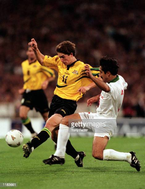 Harry Kewell of the Socceroos tries to avoid a challenge from his opponent during the 2nd leg of the World Cup Qualifier between Australia and Iran...