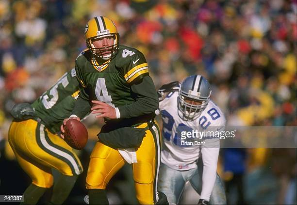 Quarterback Brett Favre of the Green Bay Packers in action during a game against the Dallas Cowboys at Lambeau Field in Green Bay Wisconsin The...