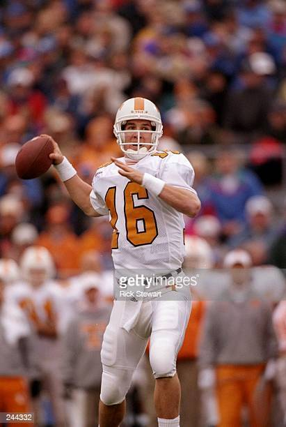 Quarterback Peyton Manning of the Tennessee Volunteers drops back to pass during a game against the Kentucky Wildcats at Commonwealth Stadium in...