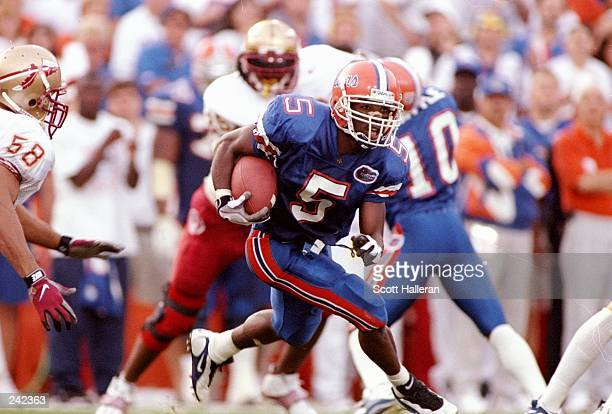 Wide receiver Jacquez Green of the Florida Gators runs with the ball during a game against the Florida State Seminoles at Florida Field in...
