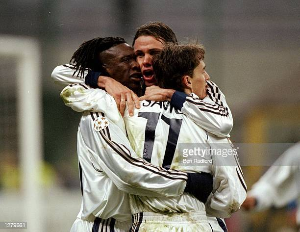 Clarence Seedorf of Real Madrid celebrates his goal with team mates Fernando Redondo and Savio during the UEFA Champions League match against Inter...