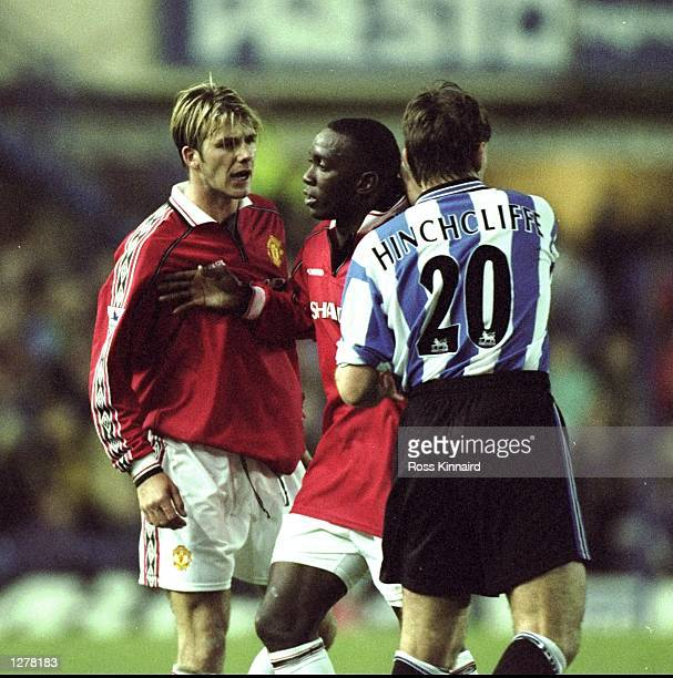 Dwight Yorke of Manchester United has to separate team mate David Beckham and Andy Hinchcliffe of Sheff Wednesday as tempers flare during the FA...