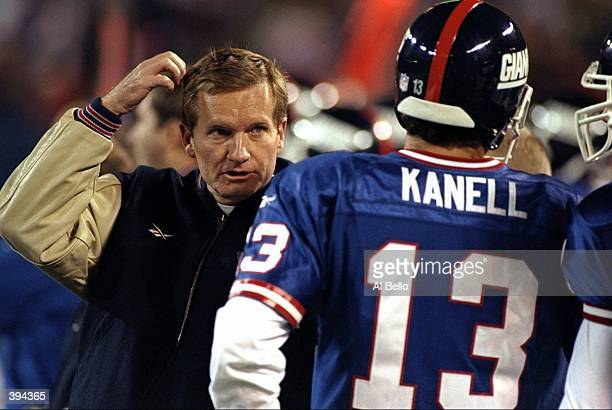 Head coach Jim Fassel of the New York Giants talks to Danny Kanell during the game against the Green Bay Packers at Giants Stadium in East Rutherford...