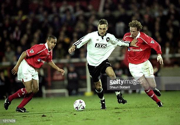 Lars Bohinen of Derby County takes on Scott Gemmil of Nottingham Forset during the FA Carling Premiership match against Nottingham Forest played at...