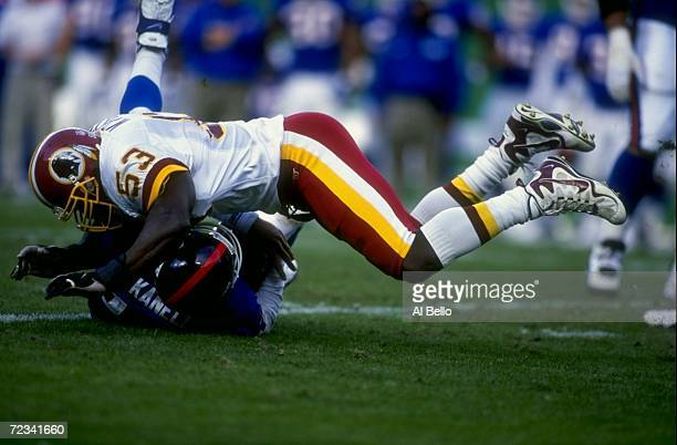 Linebacker Marvcus Patton of the Washington Redskins in action against quarterback Danny Kannell of the New York Giants during the game at the Jack...