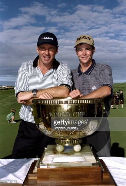 Nick Faldo and David Carter of England with the trophy after winning the World Cup of Golf at the Gulf Harbour Golf Club in Auckland New Zealand...