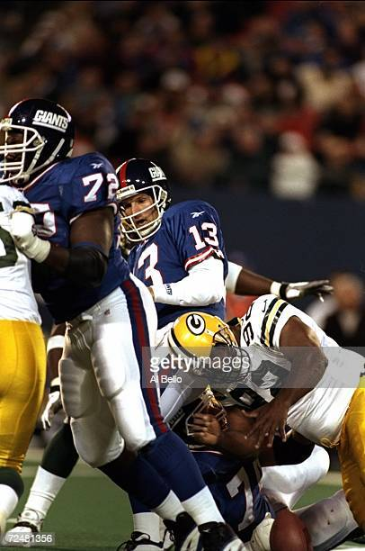 Quarterback Danny Kanell of the New York Giants in action against defensive end Reggie White of the Green Bay Packers during the game at the Giants...