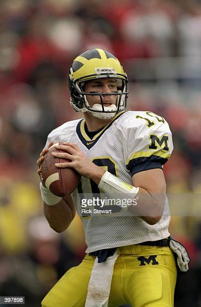 Quarterback Tom Brady of the Michigan Wolverines in action during the game against the Ohio State Buckeyes at the Ohio Stadium in Columbus Ohio The...