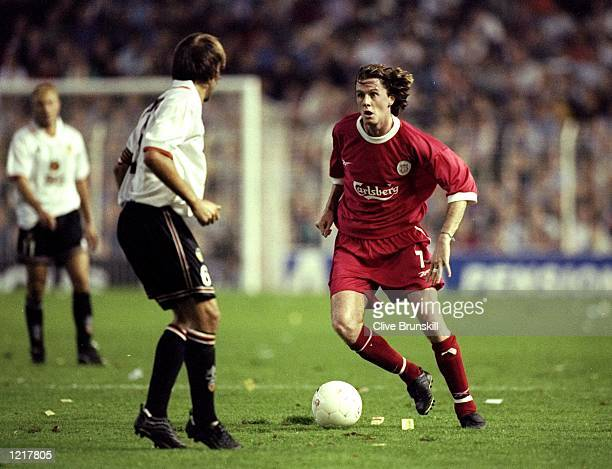 Steve McManaman of Liverpool in action against Gaizka Mendieta of Valencia during the UEFA Cup 2nd Round match against Valencia played in Valencia...