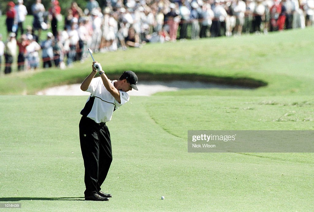 Aaron Baddeley of Australia hits an approach shot in front of a packed gallery during the final round of The Holden Australian Open Golf at The Royal Sydney Golf Course, Sydney, Australia. Aaron Baddeley of Australia won with a score of 14under. Mandatory Credit: Nick Wilson/ALLSPORT