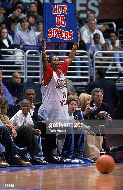 Allen Iverson's Mom of the Philadelphia 76ers stands and holds up a sign during the game against the Los Angeles Clippers at the Staples Center in...