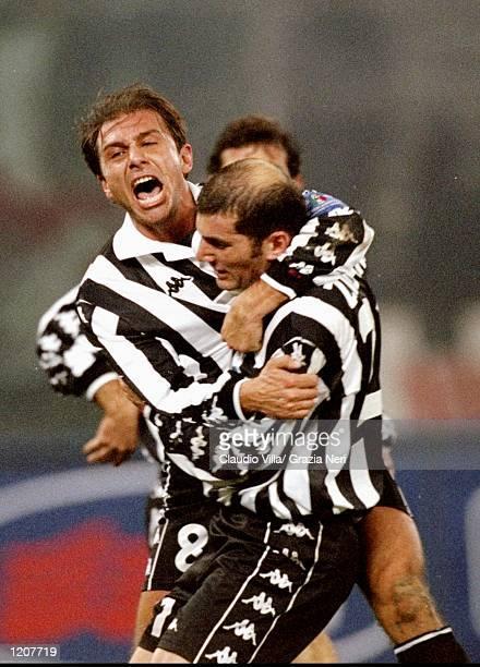 Antonio Conte and Zinedine Zidane of Juventus celebrate against AC Milan during the Italian Serie match at the Stadio Delle Alpi in Turin Italy...
