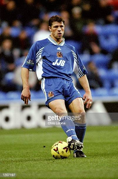 Arjan de Zeeuw of Wigan Athletic on the ball during the Nationwide League Division Two match against Burnley at the JJB Stadium in Wigan England The...