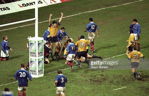 Australia celebrate Owen Finegan's try against France during the Rugby World Cup Final at the Millennium Stadium in Cardiff Wales Australia won 3512...
