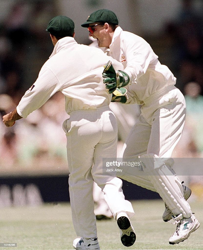 Australian fieldsman Ricky Ponting is congratulated by team mate Adam Gilchrist after he caught Pakistan batsman Saeed Anwar, during day one of the third test played between Australia and Pakistan at the WACA ground in Perth, Western Australia, Australia. Mandatory Credit: Jack Atley/ALLSPORT
