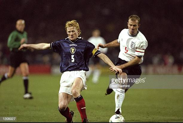 Colin Hendry of Scotland is put under pressure by Alan Shearer of England during the England v Scotland Euro 2000 playoff second leg match at Wembley...