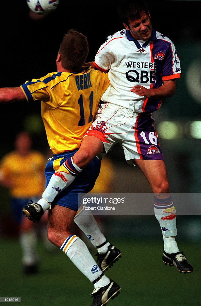 Con Boutsianis of Peth Glory leaps with Steve Berry of Parramatta Power for the ball during the round 7 match between Parramatta Power v Perth Glory at Parramatta Stadium,Sydney Australia. Mandatory Credit: Robert Cianflone/ALLSPORT