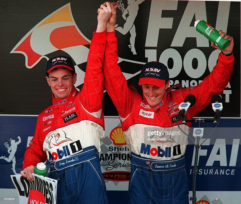 Craig Lowdnes and Cameron McConville from the Mobile Holden celebrate after winning the Drivers Championship at the end of the Bathurst FAI 1000 at Mount Panorama,Bathurst Australia. Mandatory Credit: Adam Pretty/ALLSPORT
