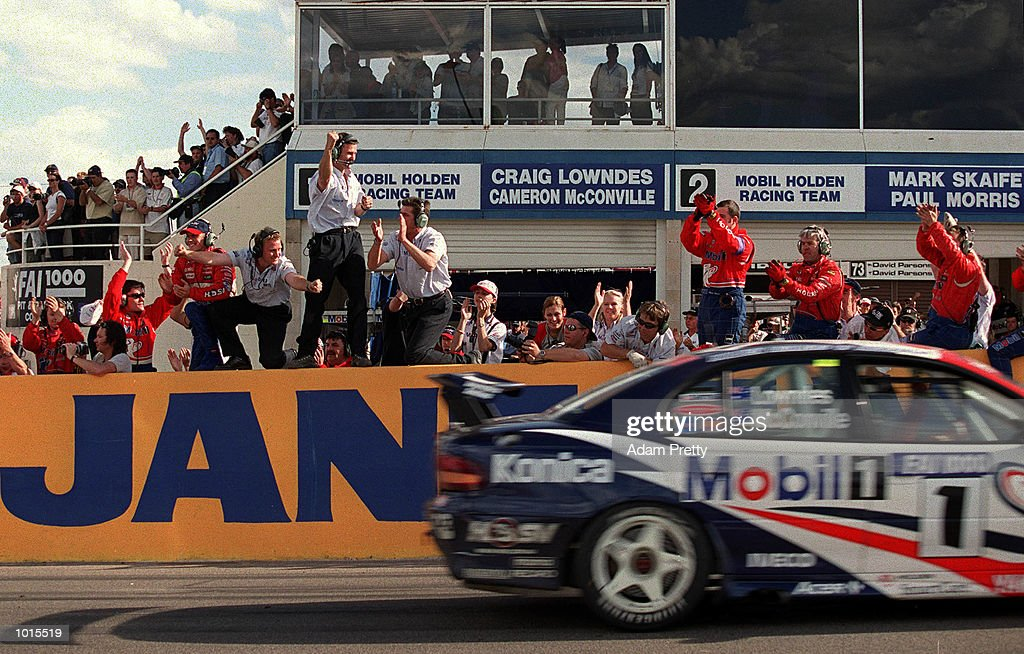 Craig Lowdnes from the Mobile Holden racing team passes the crowds after winning the Drivers Championship at the end of the Bathurst FAI 1000 at Mount Panorama,Bathurst Australia. Mandatory Credit: Adam Pretty/ALLSPORT