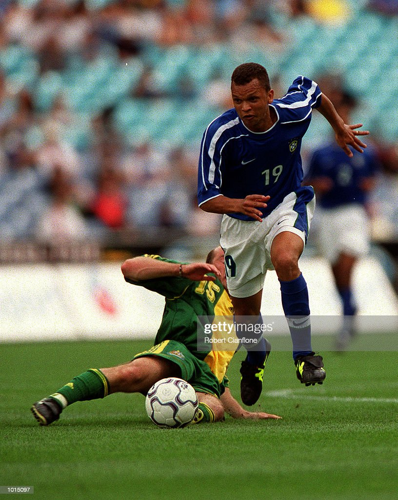 Danny Tiatto of Australia attempts to tackle Warley of Brazil during the friendly soccer game played at Stadium Australia, Homebush, Sydney, Australia. Brazil won the game two goals to nil. Mandatory Credit: Robert Cianflone/ALLSPORT