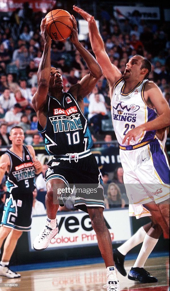 Darryl McDonald of Victoria goes up with Drew Barry of West Sydney defending, during the game between Victoria and Sydney at Melbourne Park, Melbourne, Australia. Victoria defeated Sydney 89 - 80. Mandatory Credit: Hamish Blair/ALLSPORT
